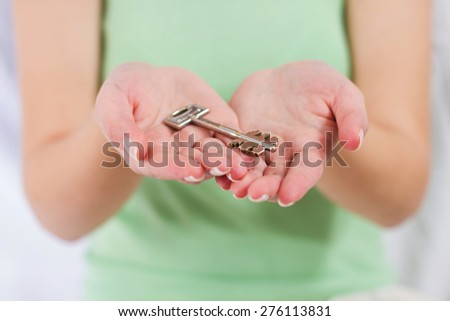 Human Hands Holds Security Key on palm. - stock photo