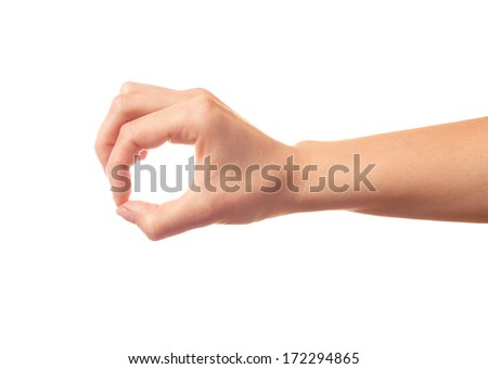 Human hands keeping something by fingers