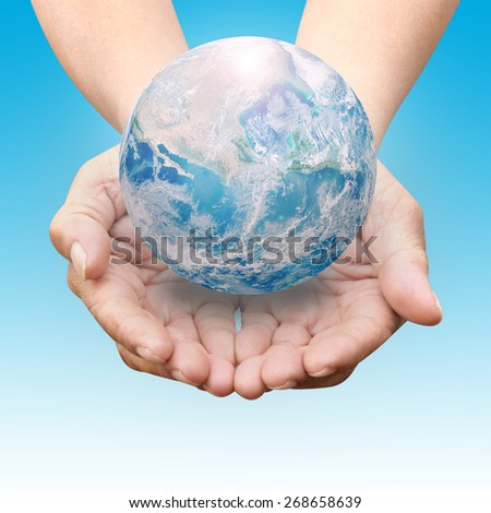 Human hands palm up with NASA global image as design element over blue shade - stock photo
