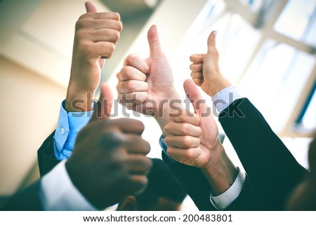Human hands showing sign of okay in isolation  - stock photo