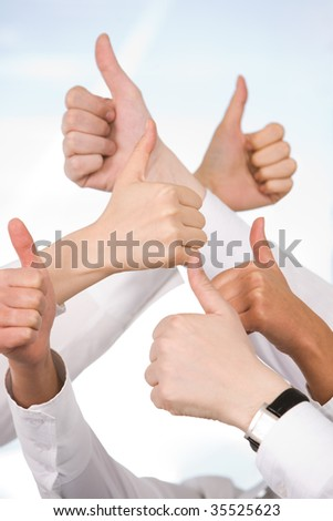 Human hands showing sign of okay isolated on blue background - stock photo