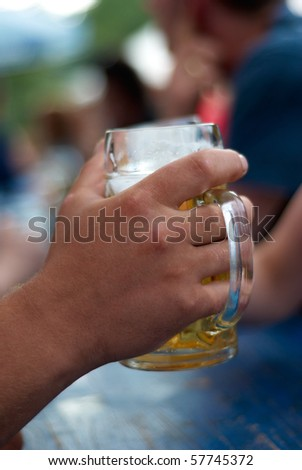 human hands toast with two glasses of beer - stock photo