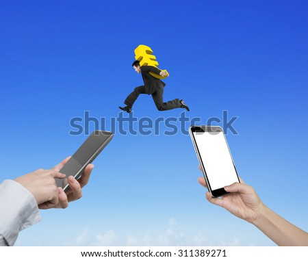 Human hands using different smart phones to transfer money, with businessman carrying euro sign jumping, electronic trading concept. - stock photo