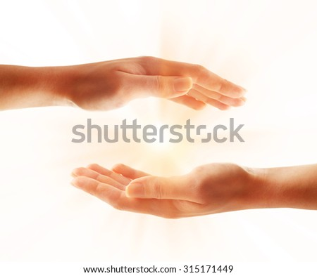 Human hands with light isolated on white - stock photo