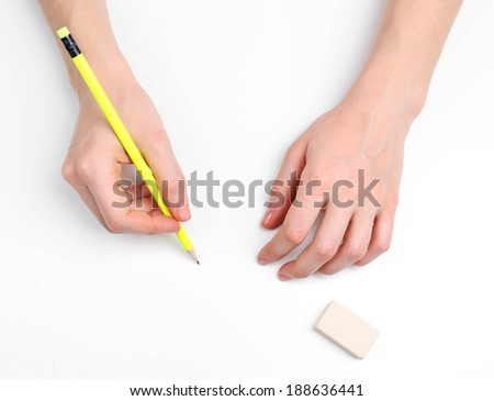 Human hands with pencil and erase rubber, isolated on white - stock photo