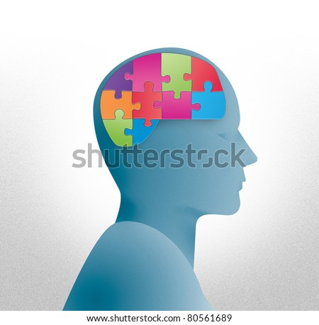 Human head silhouette with brain shaped puzzle - stock photo