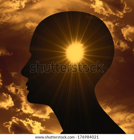 human head with light and sun clouds background - stock photo