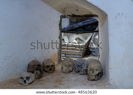 Human heads in cemetery-cellar under church - stock photo