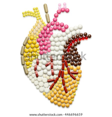 Human heart shape of pills, isolated on white.