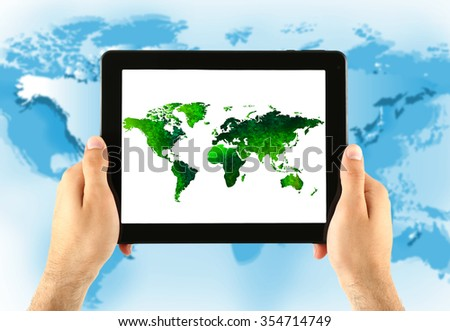 Human holding tablet pc  with world map and network on screen
