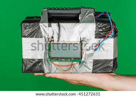 Human holding timebomb in his hands. terrorism and dangerous life concept. image on green background chromakey. - stock photo