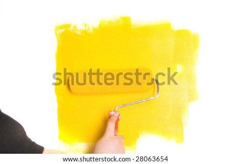 Human is painting a wall - stock photo