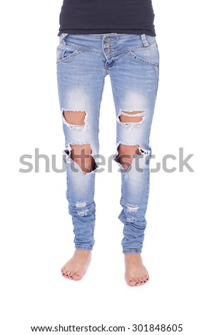 human legs in the ripped jeans - stock photo
