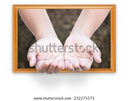 Human open empty hands with palms up from frame of ground background. - stock photo