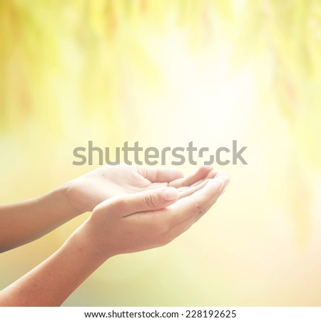 Human open empty hands with palms up, over blurred nature background. Thanksgiving, Christmas, Forgiveness, Mercy, Humble, Repentance, Reconcile, Glorify, World environment day concept.
