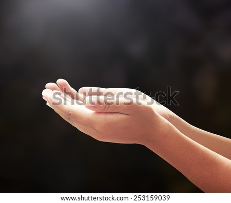 Human open two empty hands with palms up. Ask Pose Seek Beg Help Race God Well Relax Soul Pray Dua Hajj Give Child Girl Bless Quran Aura Heal Life Gift Eid Poor Idea Islam Thank Room Mercy Candle Glow - stock photo