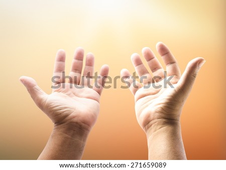 Human open two empty hands with palms up. Ask Pose Seek Beg Help Race God Well Soul Pray Dua Hajj Give Bless Quran Aura Heal Life Gift Eid Poor Idea Islam Thank Room World Candle Glow Prayer concept - stock photo