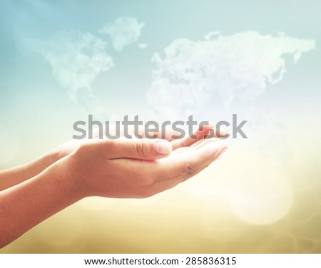 Human open two empty hands with palms up. World Map Ask Pose Seek Beg Help God Well Relax Soul Prayer Dua Hajj Gives Child Girl Bless Quran Aura Heal Gift Eid Idea Islam Thank Room Mercy Trust Glow - stock photo
