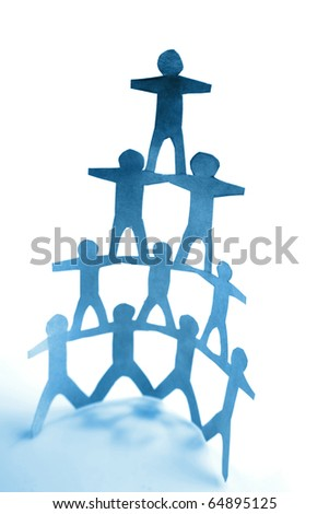 Human pyramid standing on plain background - stock photo
