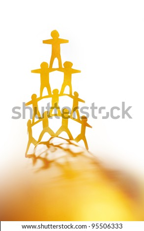 Human pyramid team - stock photo