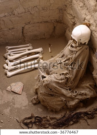 Human remains inside tomb from the Nazca culture. Cemetery de Chauchilla, Nazca, Peru. - stock photo