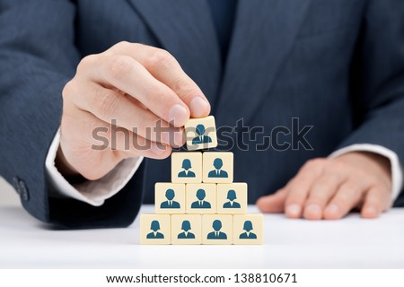 Human resources and corporate hierarchy concept - recruiter complete team by one leader person (successor, CEO) represented by icon. - stock photo