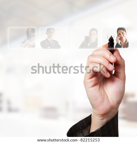 Human Resources concept: choosing the perfect candidate for the job through a digital touch screen - stock photo