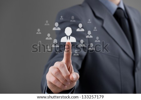 Human resources officer choose employee standing out from the crowd. Select team leader (successor) or assessment center concept. Gender discrimination in employees selection. - stock photo