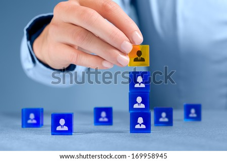 Human resources officer install one person as team leader. Team composition, team configuration, teamwork, cooperation and team leader (CEO) concepts. - stock photo