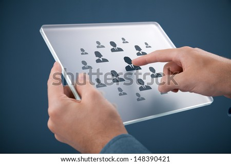 Human resources, personal audit, CRM, and assessment center concept - recruiter select employee (or team leader) represented by icon on futuristic glass tablet.  - stock photo