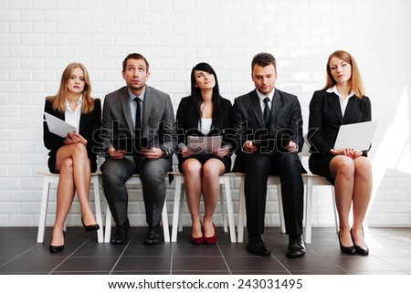 Human resources. Stressed business people before interview - stock photo