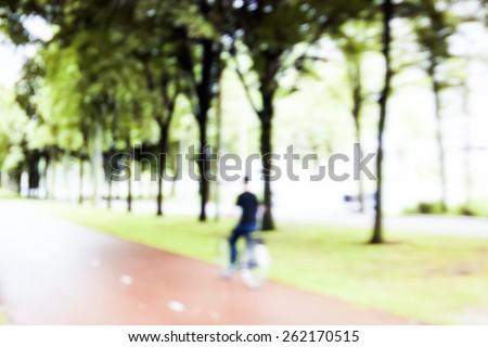 Human ride bicycle blur - stock photo
