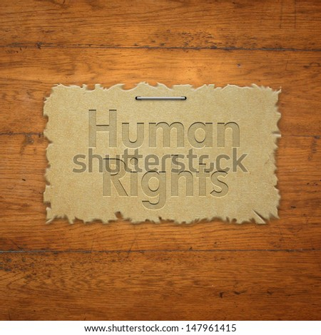 Human rights on torn paper - stock photo