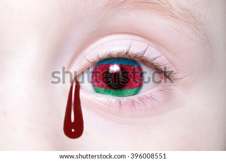 human's eye with national flag of azerbaijan with bloody tears. concept - stock photo