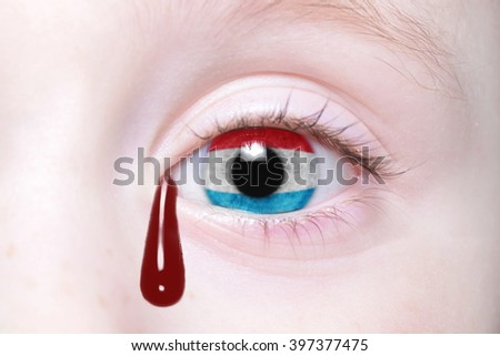 human's eye with national flag of luxembourg with bloody tears. concept - stock photo