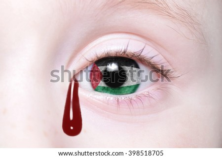 human's eye with national flag of palestine with bloody tears. concept
