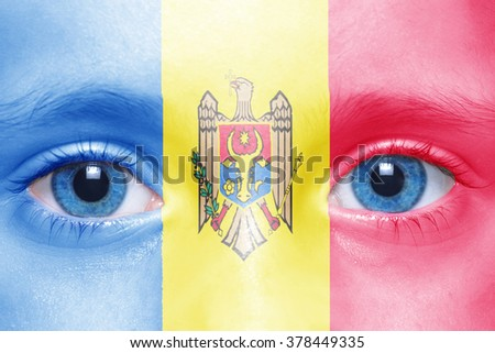 human's face with moldavian flag