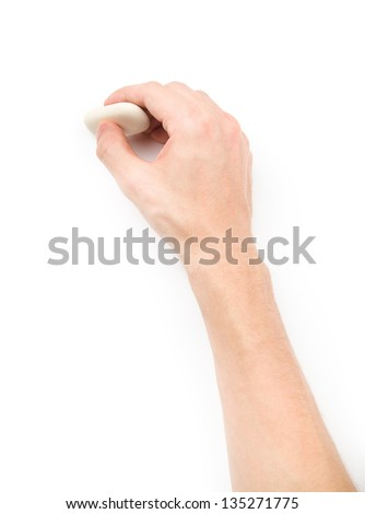 Human's hand erasing something on white background