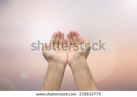 Human's hands gesture pray on blurred sunset/sunrise nature background,soft focus:assistance and support.love and caring concept.forgiveness and blessing humanity conceptual.strength concept.helping - stock photo