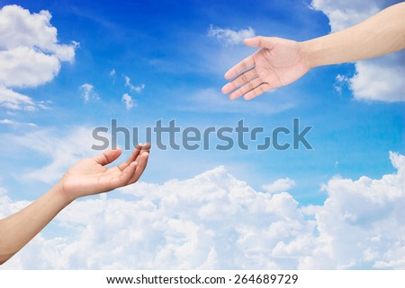 Human's hands help together on blue sky backgrounds  isolated with path / paths - stock photo
