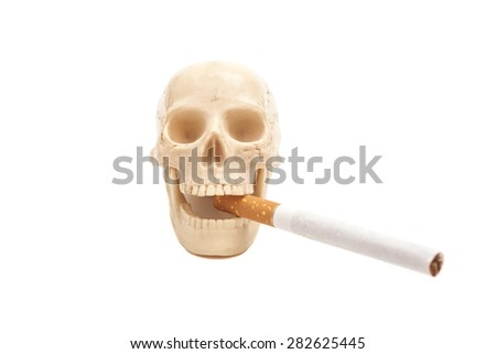 Human scull with cigarette isolated on white - stock photo