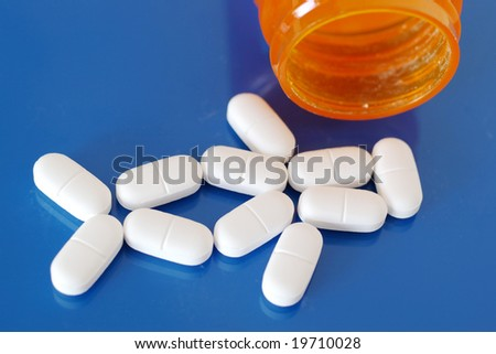 Human shaped pills with bottle. See more medical images in my portfolio.