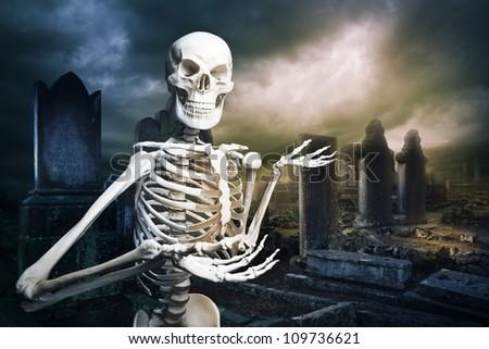 human skeleton in a graveyard at Halloween - stock photo