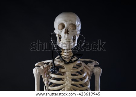 Human skeleton with stethoscope