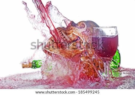 Human skull action series   on wine bathing - stock photo