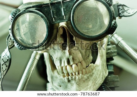 Human skull with insane look and goggles (robot) - stock photo