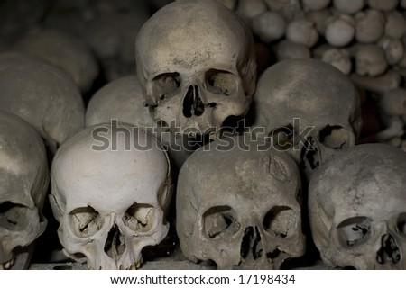 Human skulls at the Kutna Hora ossuary - stock photo
