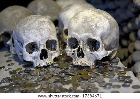 Human skulls at the Kutna Hora ossuary - stock photo
