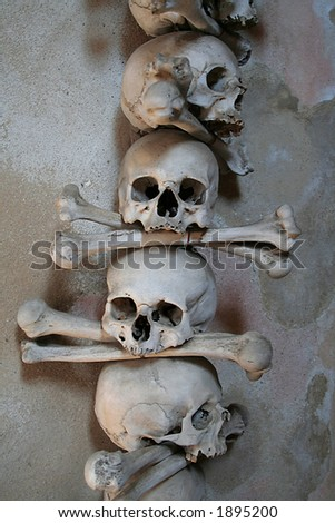 Human skulls at the Kutna Hora ossuary: a chapel made out of human bones - stock photo