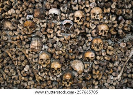 Human skulls form a heart inside Paris Catacomb - stock photo